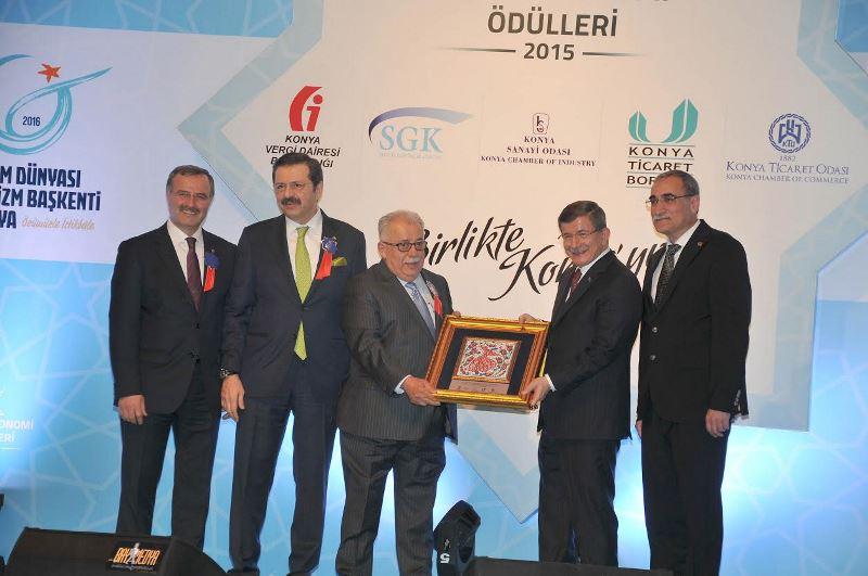 Başbakan'dan Atiker'e çifte ödül